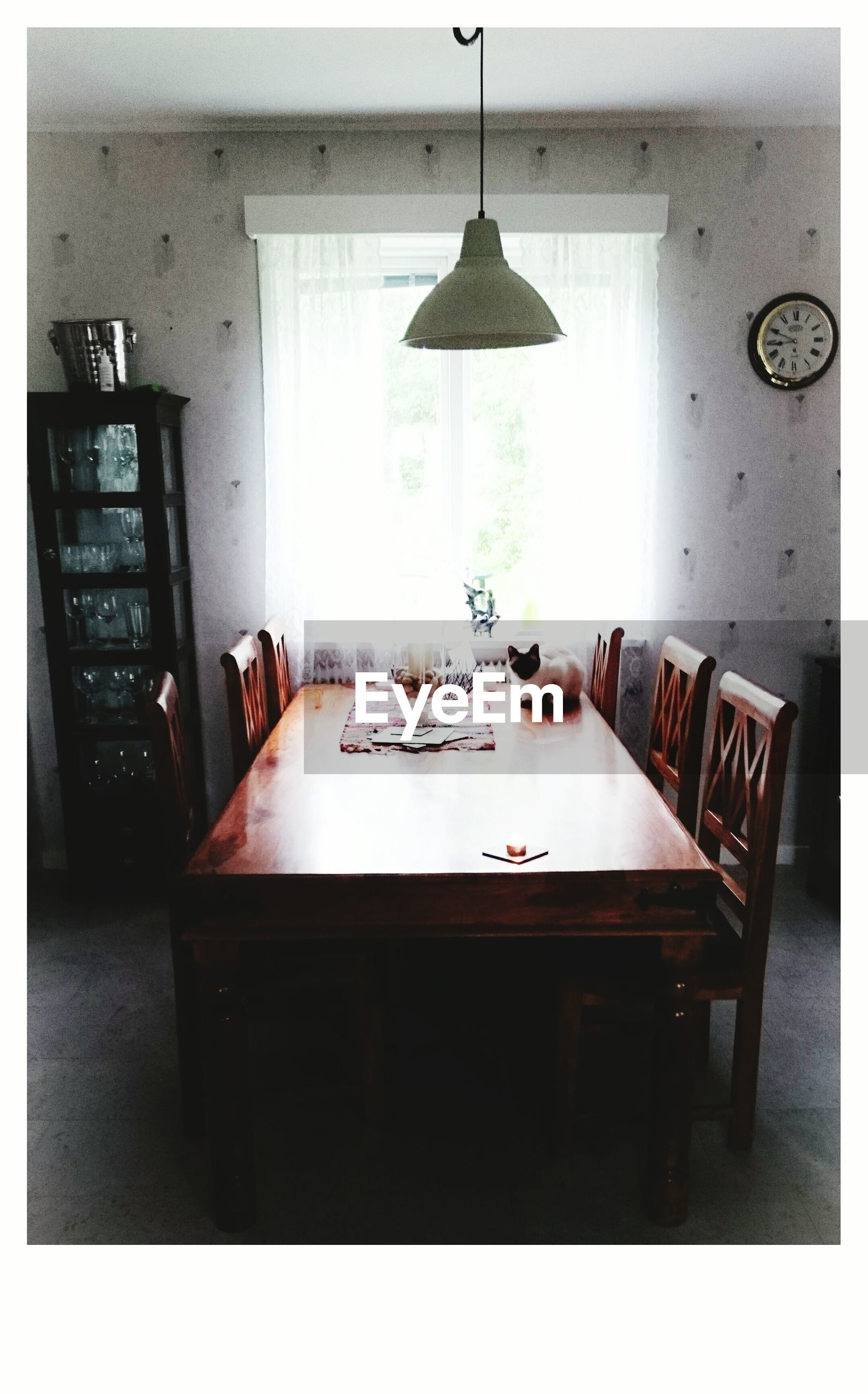 indoors, table, transfer print, chair, absence, empty, home interior, auto post production filter, lighting equipment, still life, furniture, no people, electric lamp, wall - building feature, architecture, restaurant, room, domestic room, picture frame, built structure