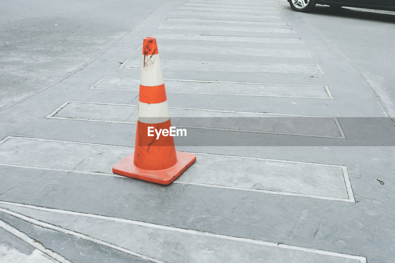 traffic cone, cone, road, safety, security, sign, protection, transportation, guidance, high angle view, day, city, symbol, street, orange color, no people, outdoors, road marking, marking, white color, rules, warning symbol, road warning sign