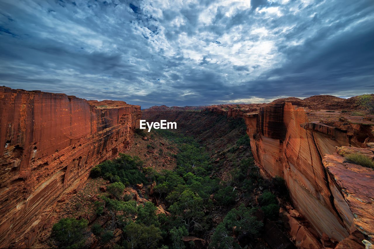 Scenic view of rock formations at kings canyon against cloudy sky