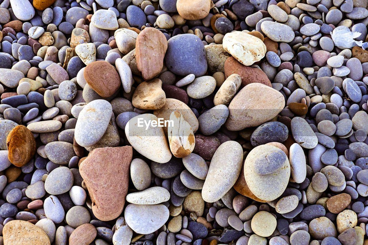 High Angle View Of Pebble Stones On Beach