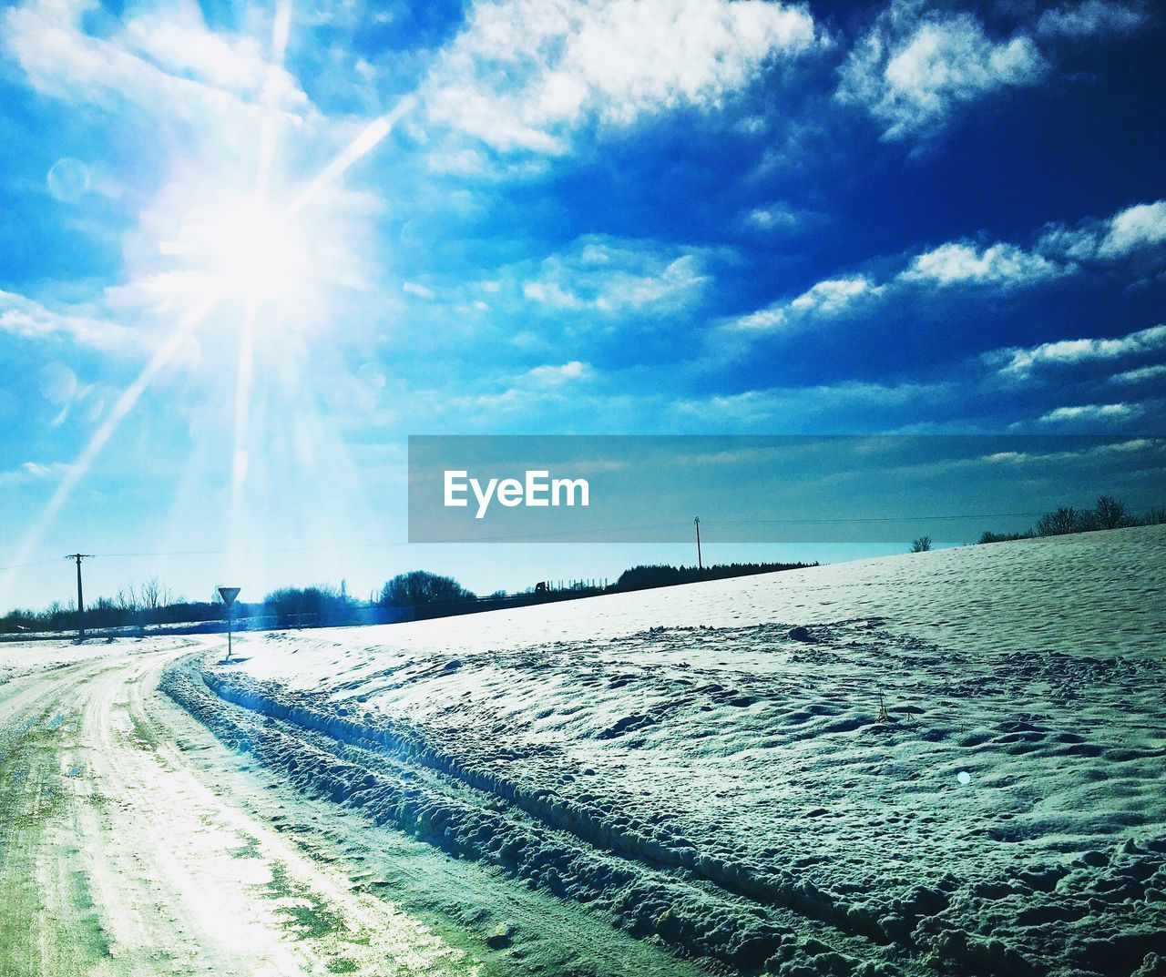 sunbeam, lens flare, sun, sunlight, outdoors, sky, day, no people, nature, tranquility, road, scenics, landscape, tranquil scene, the way forward, beauty in nature, cold temperature, winter, snow, water