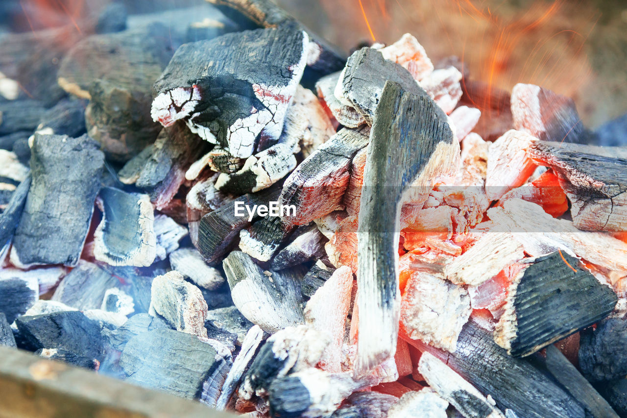 burning, log, close-up, fire - natural phenomenon, fire, heat - temperature, wood - material, firewood, flame, wood, ash, no people, nature, day, large group of objects, selective focus, coal, burnt, outdoors, stack, bonfire