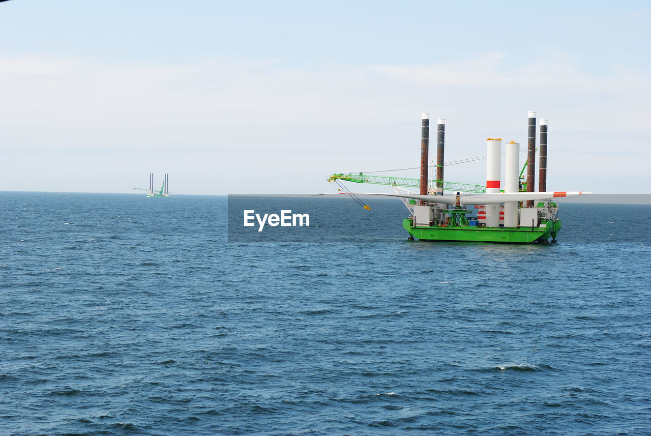 sea, water, waterfront, nature, horizon over water, fuel and power generation, day, outdoors, oil industry, scenics, no people, transportation, sky, beauty in nature, industry, nautical vessel, offshore platform, drilling rig, oil pump