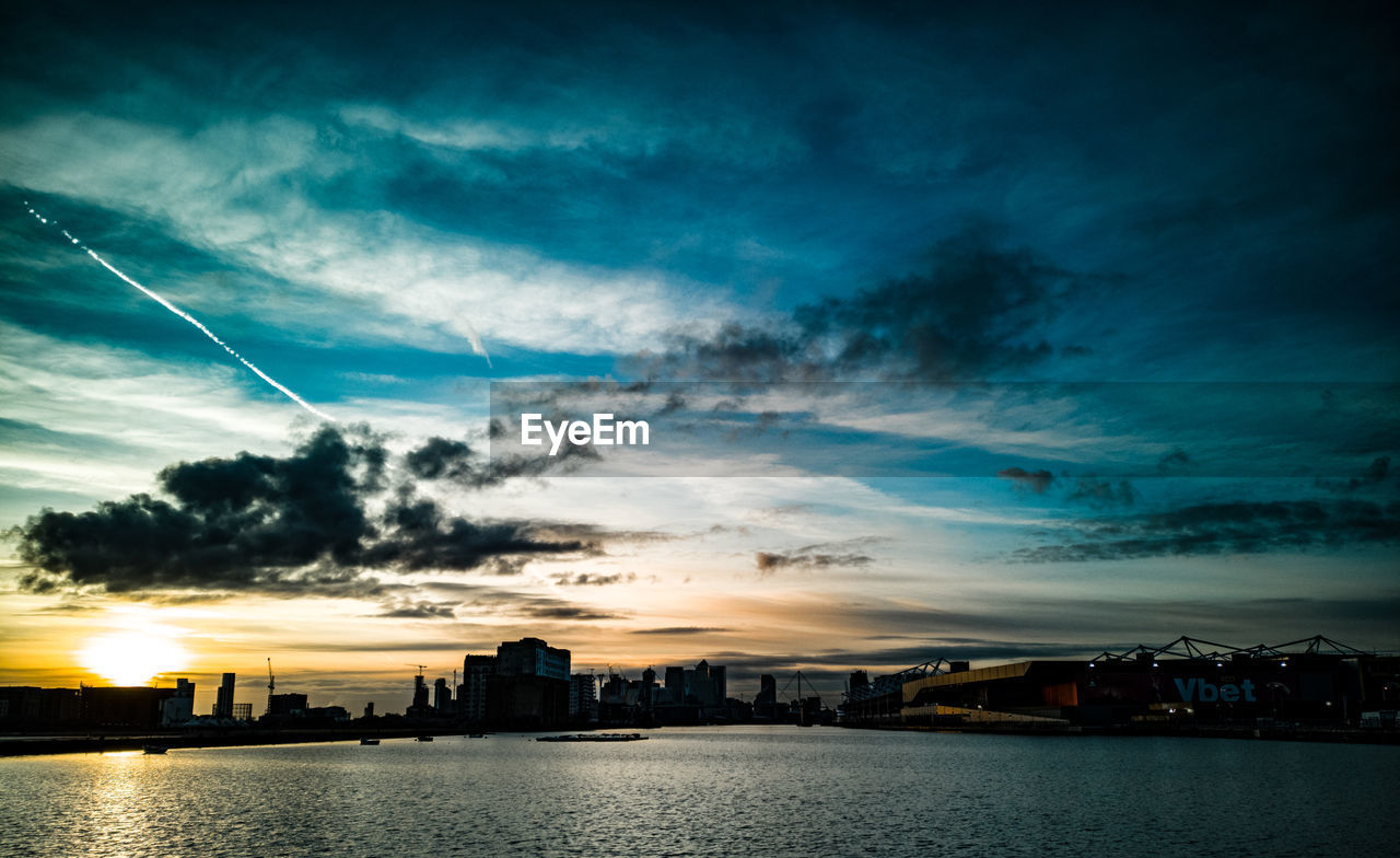 cloud - sky, sky, building exterior, architecture, built structure, water, sunset, city, nature, building, no people, waterfront, beauty in nature, scenics - nature, outdoors, cityscape, sea, dramatic sky, office building exterior, skyscraper