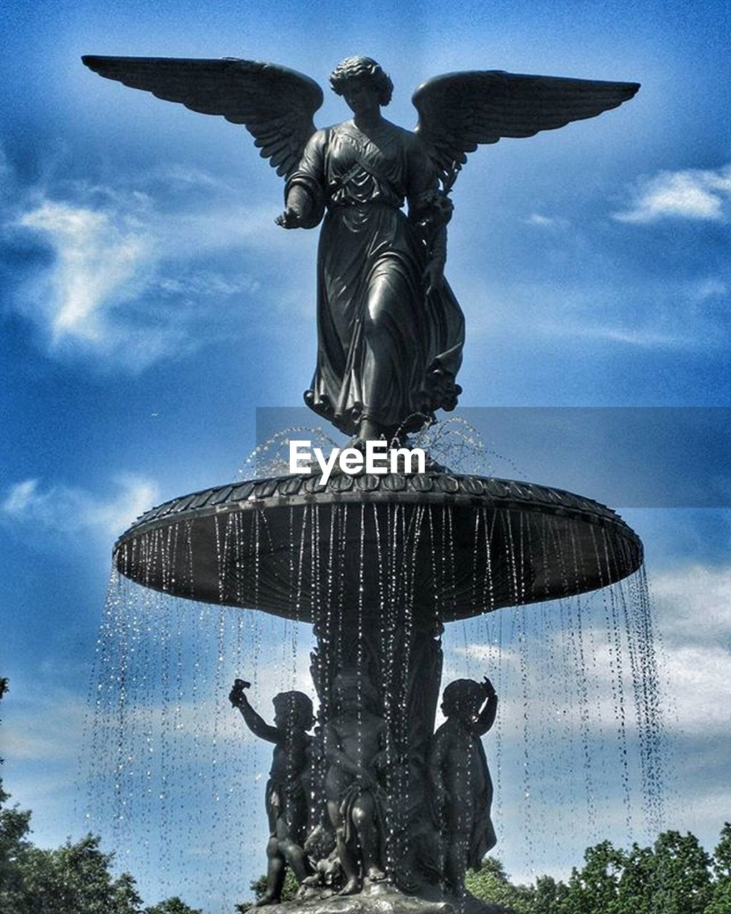 statue, sculpture, human representation, art and craft, fountain, male likeness, sky, cloud - sky, low angle view, day, no people, outdoors, motion, water, nature