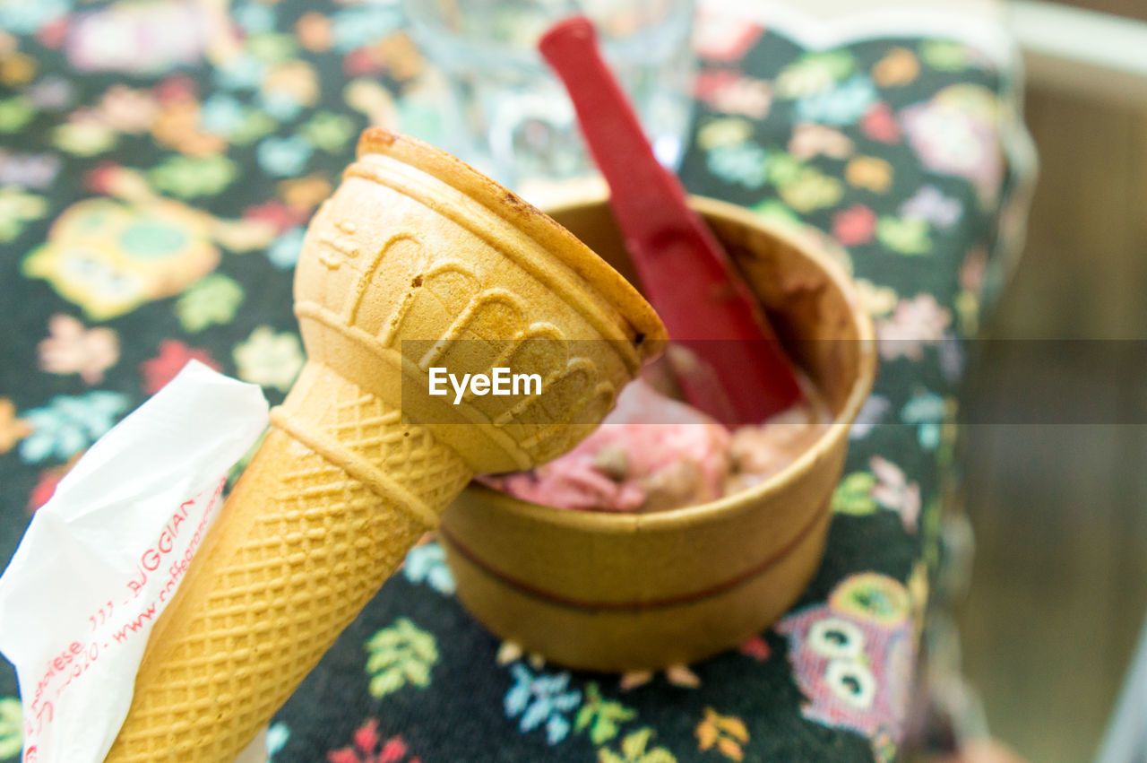 food and drink, food, sweet, sweet food, ice cream, dairy product, dessert, close-up, unhealthy eating, frozen food, focus on foreground, ice cream cone, freshness, indulgence, cone, frozen, temptation, still life, indoors, ready-to-eat, no people, floral pattern
