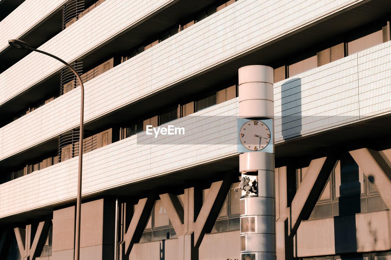 Clock beside japanese building