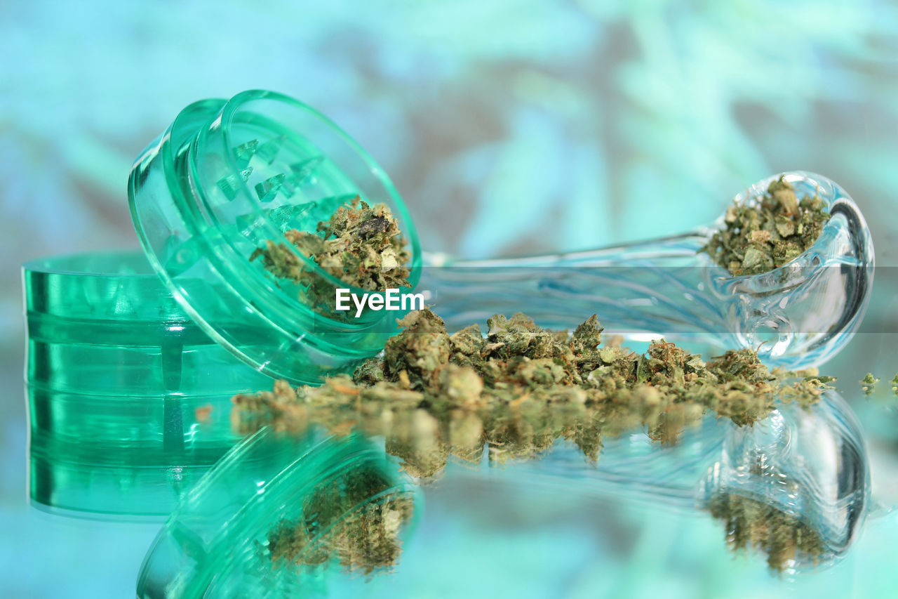 Close-Up Of Cannabis On Glass Table