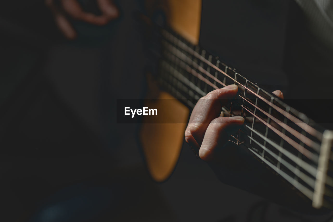 music, string instrument, guitar, musical instrument, playing, arts culture and entertainment, musical equipment, string, real people, musician, musical instrument string, one person, artist, human hand, lifestyles, holding, hand, plucking an instrument, skill, men, acoustic guitar, finger