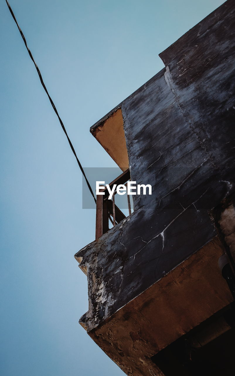 sky, low angle view, built structure, clear sky, architecture, no people, nature, metal, building exterior, old, day, outdoors, technology, rusty, blue, industry, wood - material, connection, weathered, cable, power supply, construction equipment