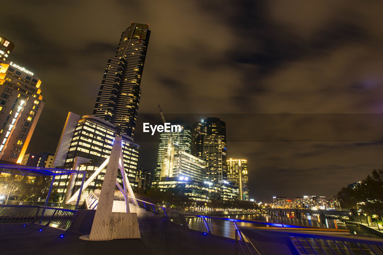 illuminated, night, building exterior, architecture, built structure, skyscraper, city, sky, travel destinations, outdoors, no people, water, nautical vessel, modern, cityscape, nature