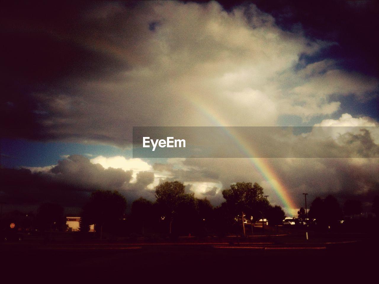 Scenic view of rainbow over city
