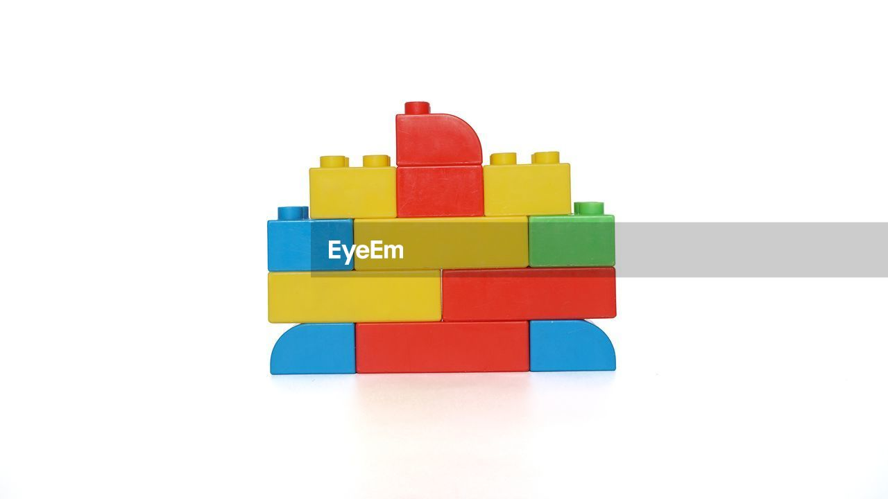 CLOSE-UP OF TOYS AGAINST WHITE BACKGROUND