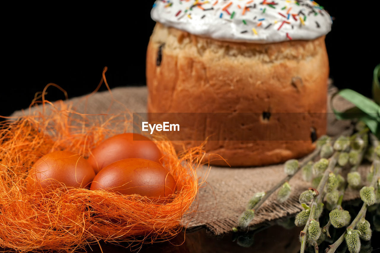food and drink, food, freshness, still life, close-up, selective focus, egg, indoors, healthy eating, no people, container, wellbeing, table, brown, basket, nature, black background, vegetable, focus on foreground, nut, temptation