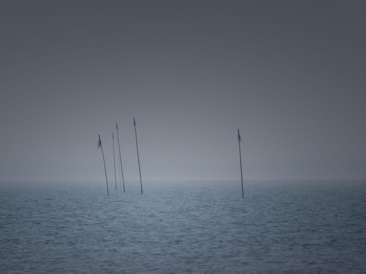 waterfront, water, horizon over water, horizon, sea, sky, beauty in nature, tranquil scene, scenics - nature, tranquility, no people, nature, fog, seascape, outdoors, copy space, day, non-urban scene