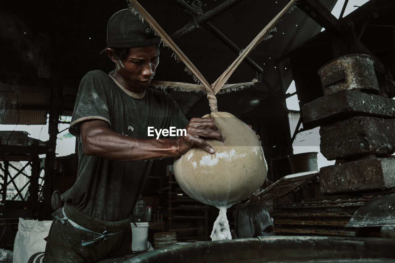 MAN WORKING WITH FOOD