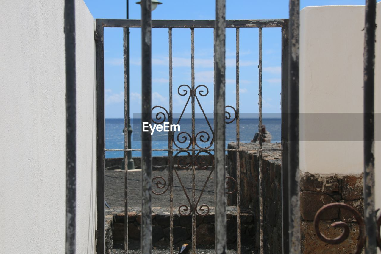 architecture, window, built structure, day, metal, no people, protection, security, safety, building, sky, outdoors, grid, building exterior, door, entrance, closed, water, grate, iron - metal, wrought iron, iron