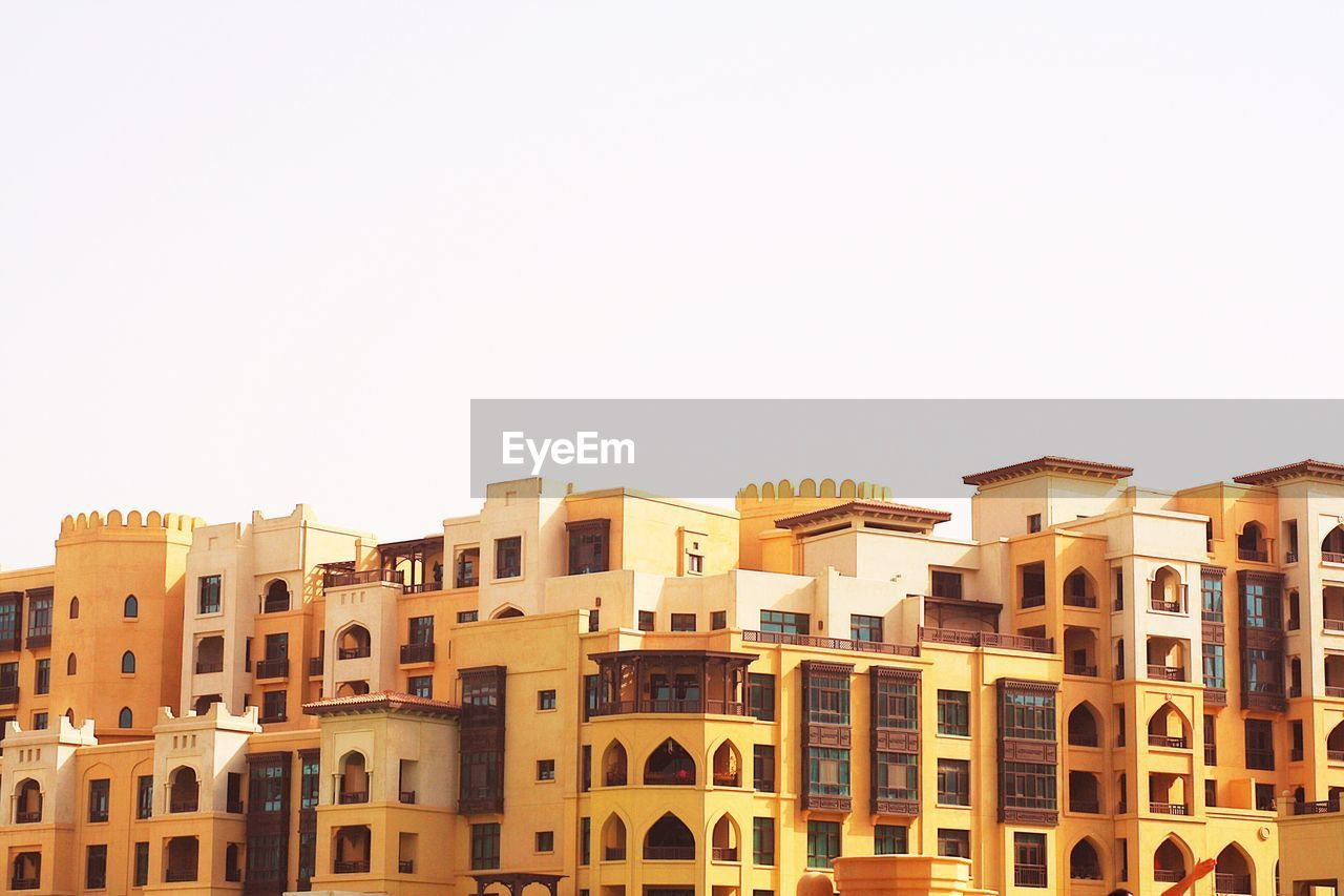 Low angle view of buildings against clear sky, dubai traditional architect building