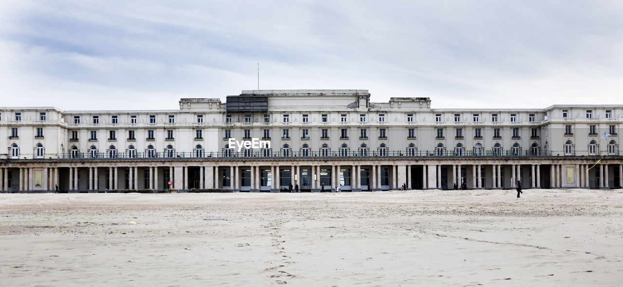 architecture, building exterior, built structure, travel destinations, sand, sky, cloud - sky, beach, day, outdoors, no people