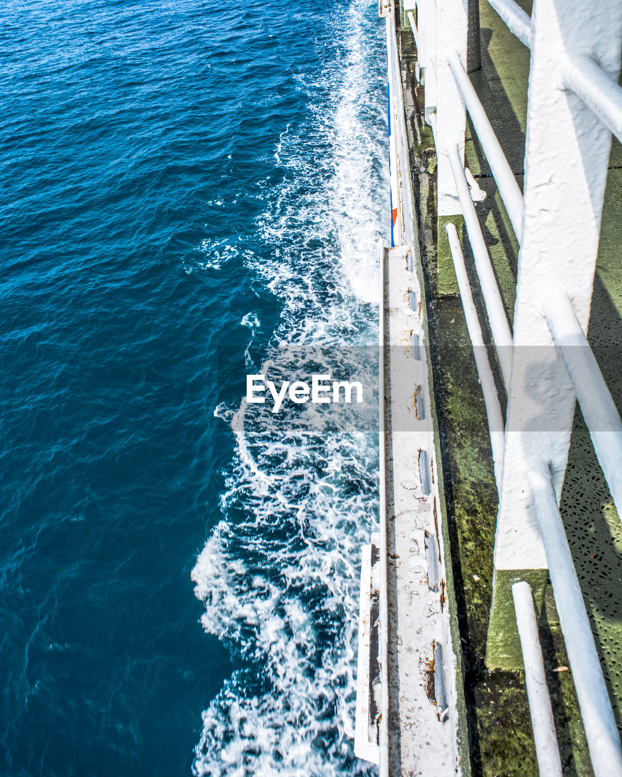High angle view of railing of pier over sea