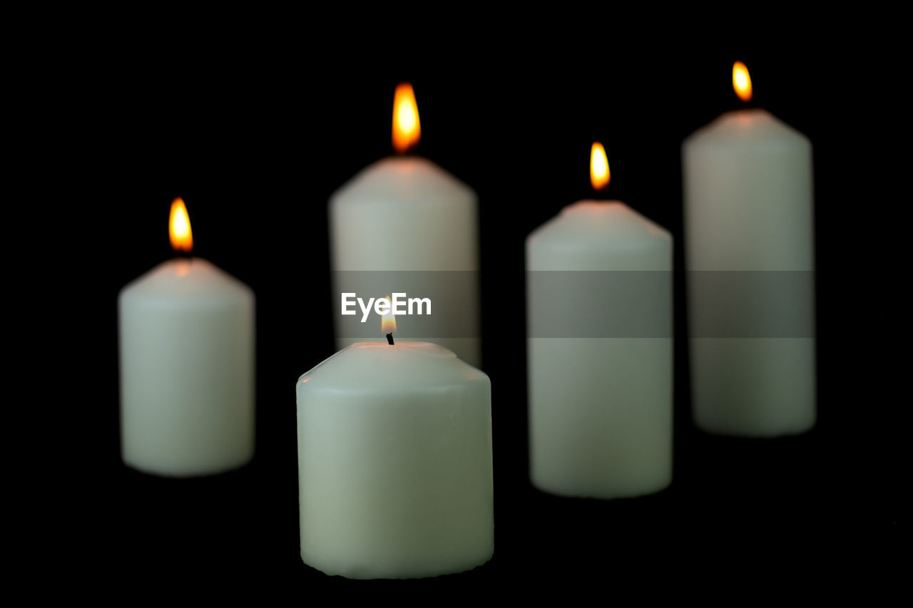 candle, indoors, burning, flame, fire, close-up, no people, illuminated, white color, group of objects, studio shot, dark, black background, focus on foreground, glowing, wax, heat - temperature, side by side, still life, copy space, melting