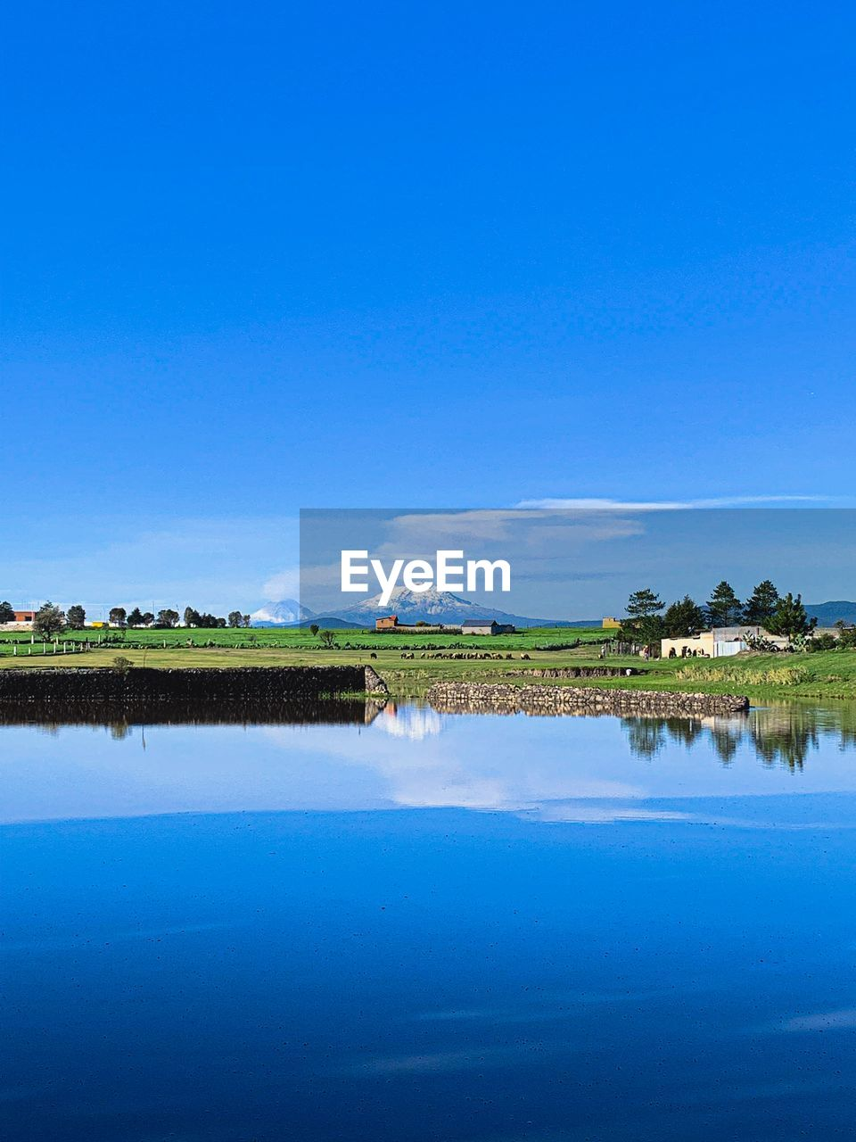water, blue, sky, reflection, scenics - nature, tranquil scene, beauty in nature, waterfront, tranquility, lake, nature, copy space, plant, no people, clear sky, standing water, day, idyllic, non-urban scene, outdoors, swimming pool