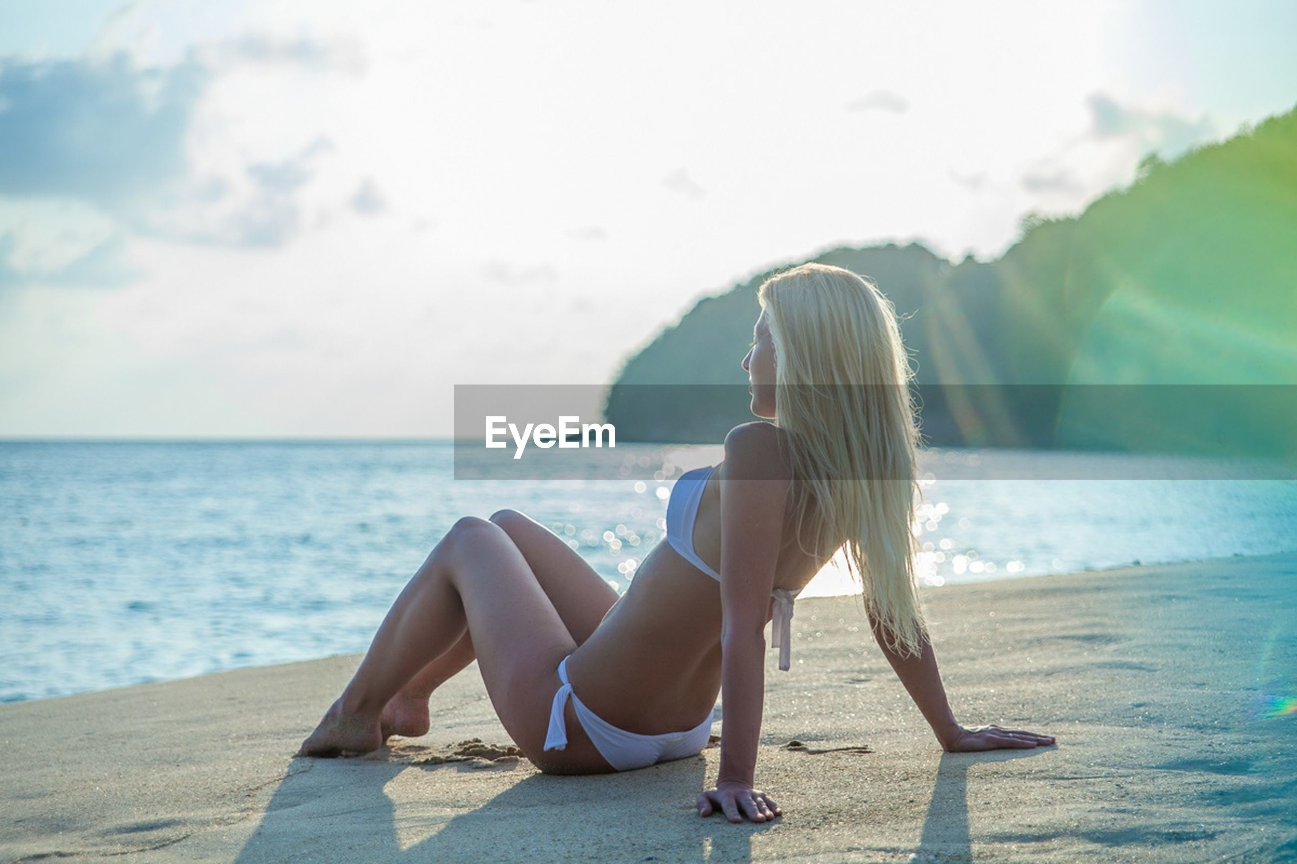 sea, horizon over water, beach, water, leisure activity, lifestyles, sky, rear view, shore, person, vacations, scenics, relaxation, tranquility, tranquil scene, sand, beauty in nature, nature