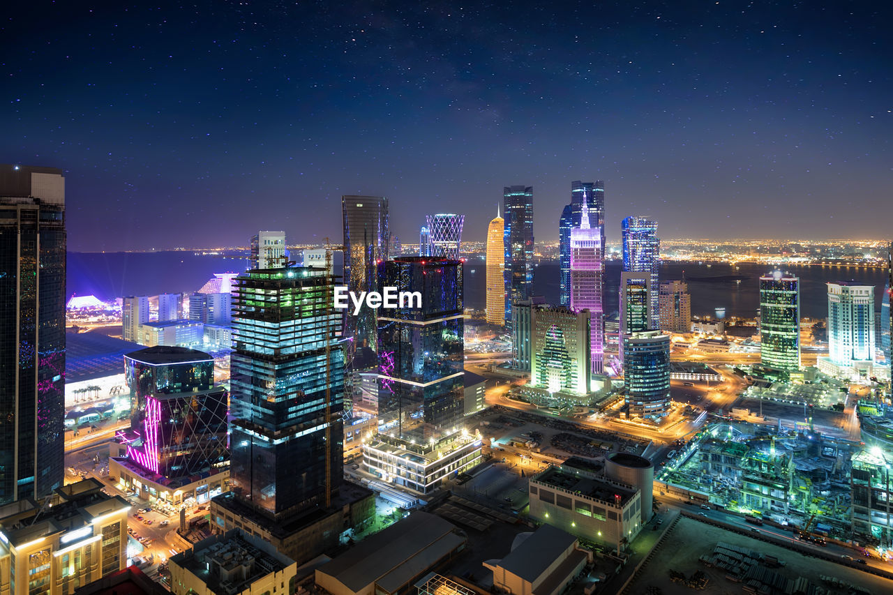 building exterior, architecture, illuminated, night, city, cityscape, built structure, office building exterior, sky, building, skyscraper, tall - high, modern, no people, city life, nature, tower, office, outdoors, financial district