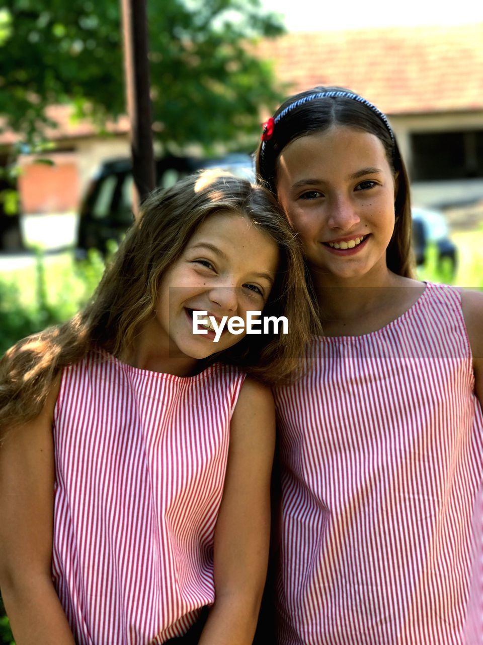 Portrait of smiling teenage girls