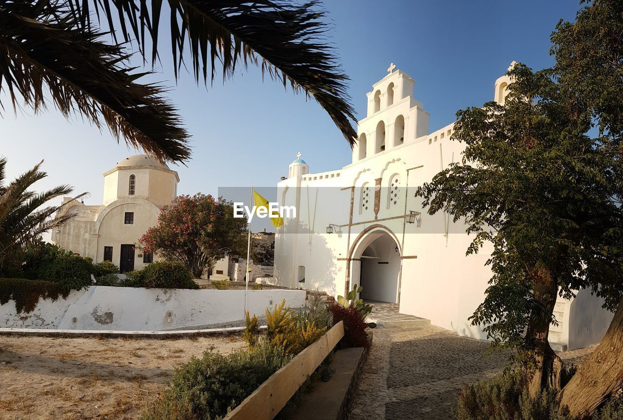 Tree Religion Architecture Building Exterior Built Structure Spirituality Sky Water No People Place Of Worship Palm Tree City Outdoors Day Santorini, Greece