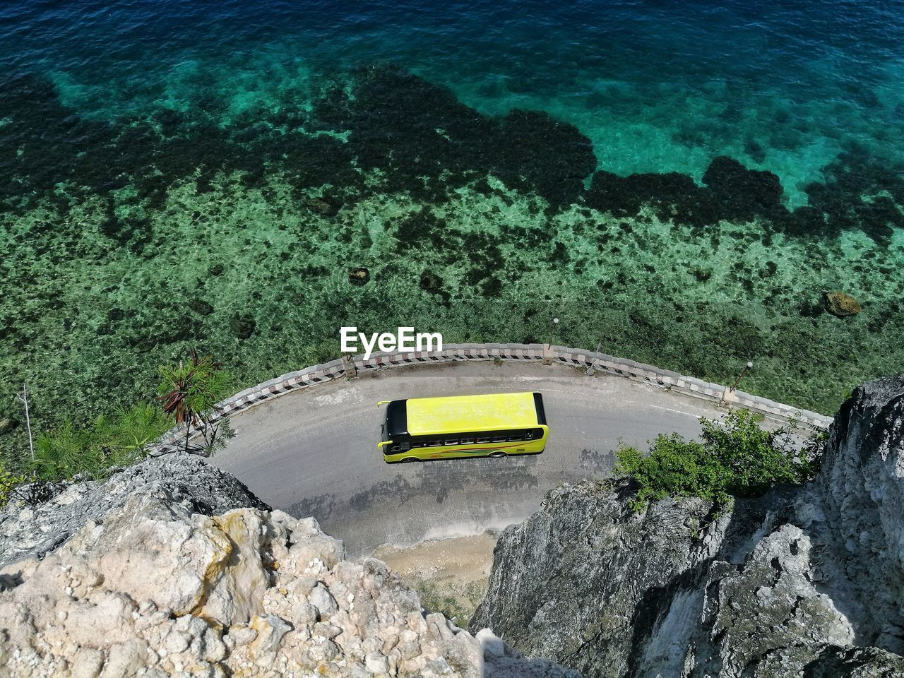 high angle view, rock - object, water, transportation, sea, no people, nature, outdoors, day, yellow, beauty in nature, mountain