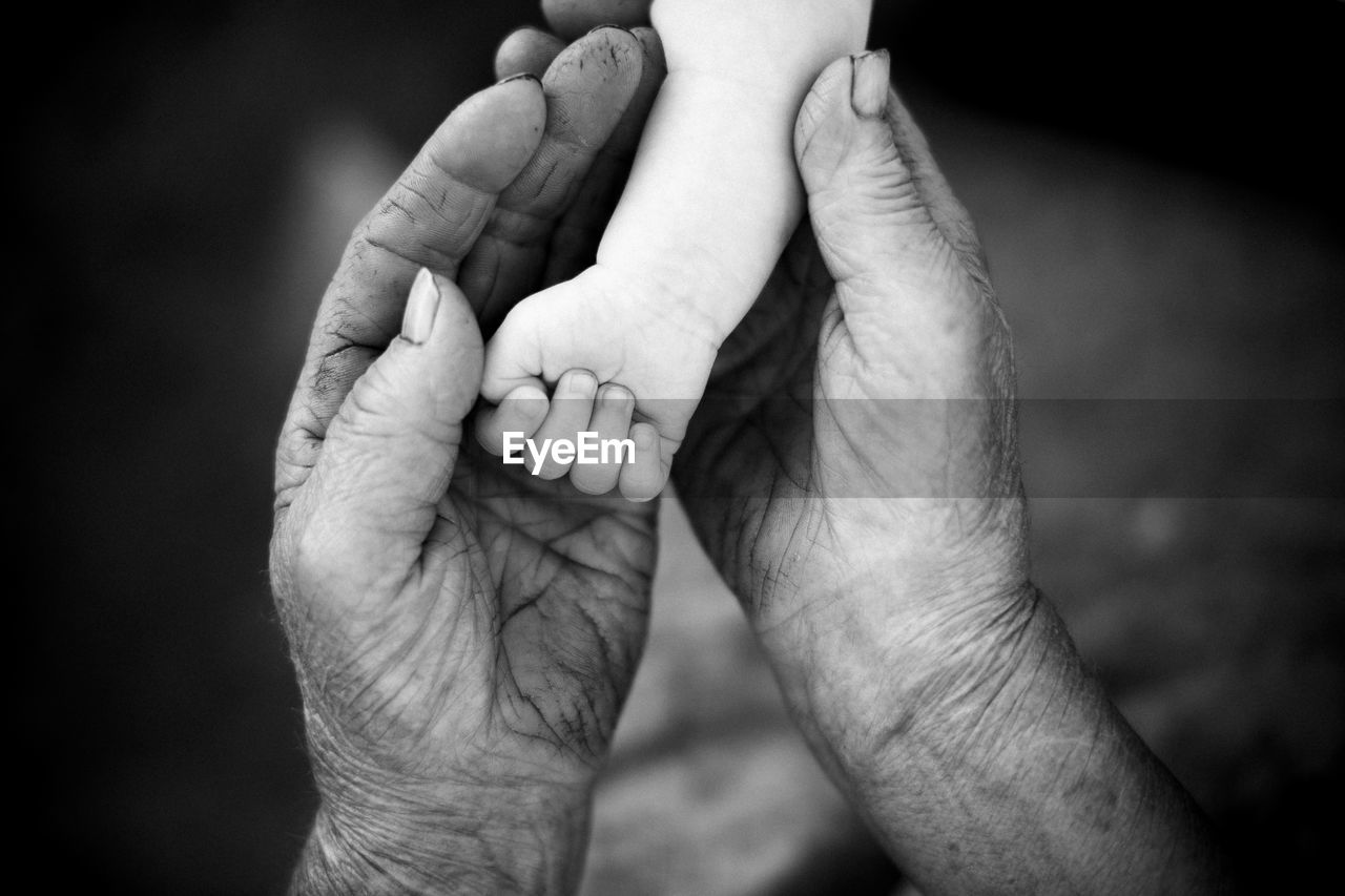 Youth and old age. hands of grandmother and granddaughter. high quality photo
