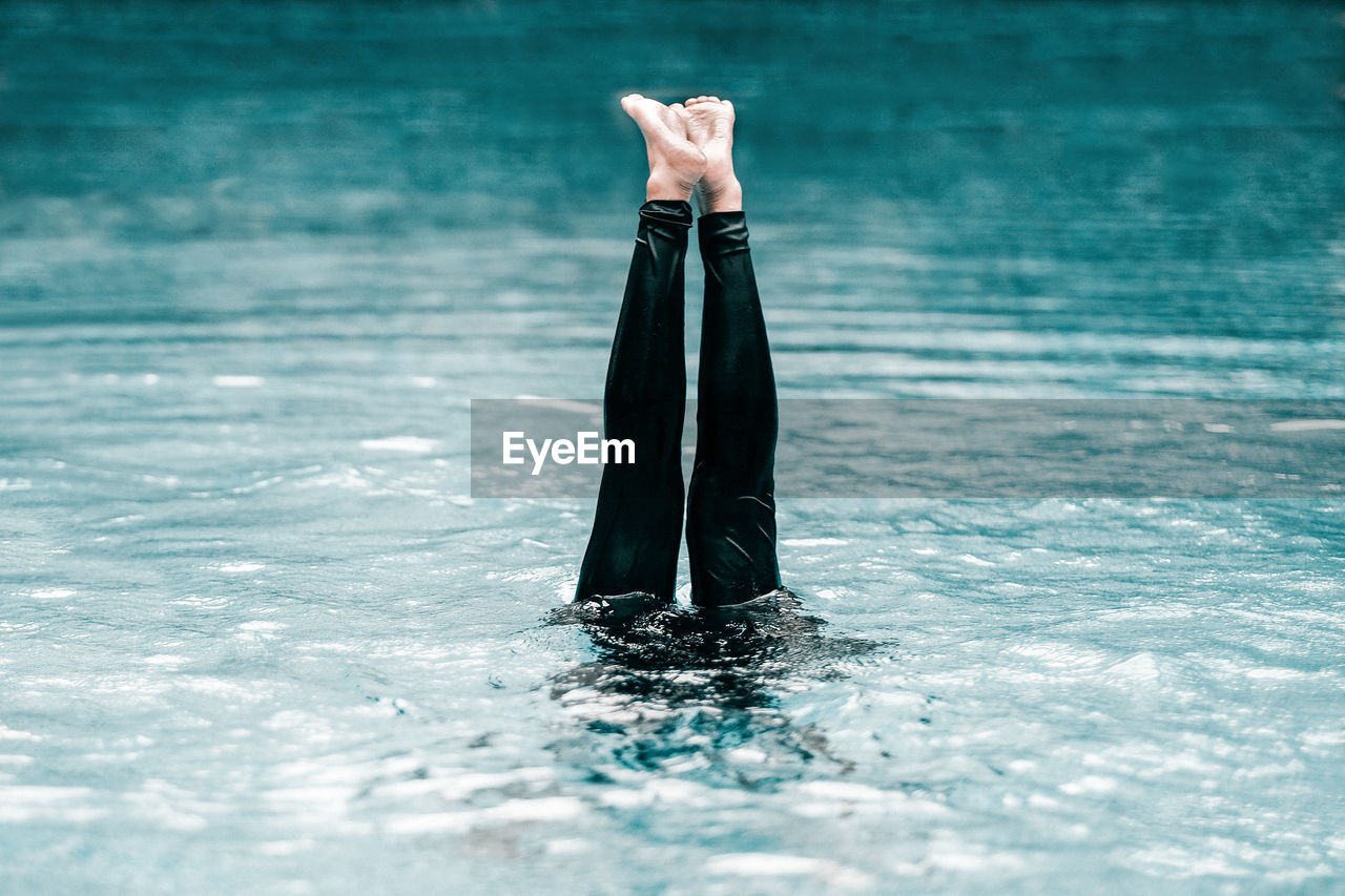 Cropped Image Of Woman Leg In Swimming Pool