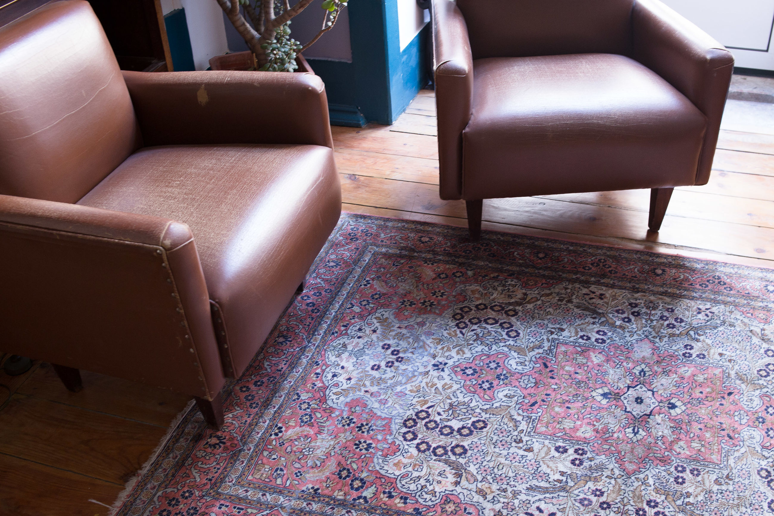 High angle view of armchairs on carpet in living room at home
