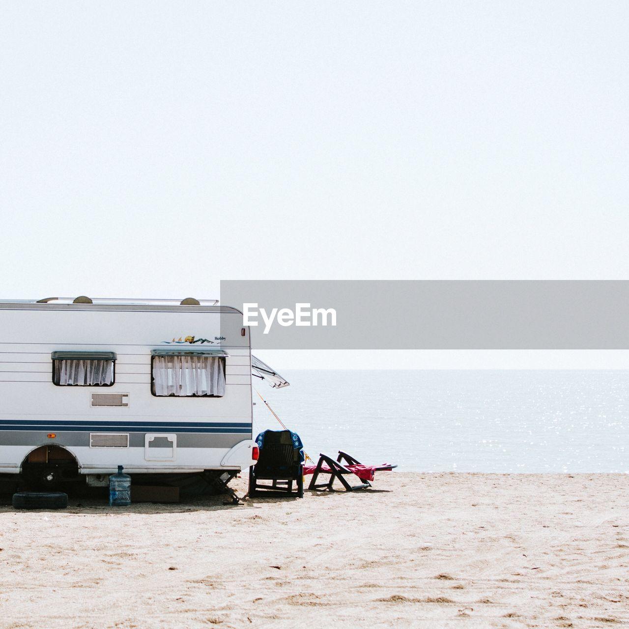 Caravan On Beach Against Clear Sky