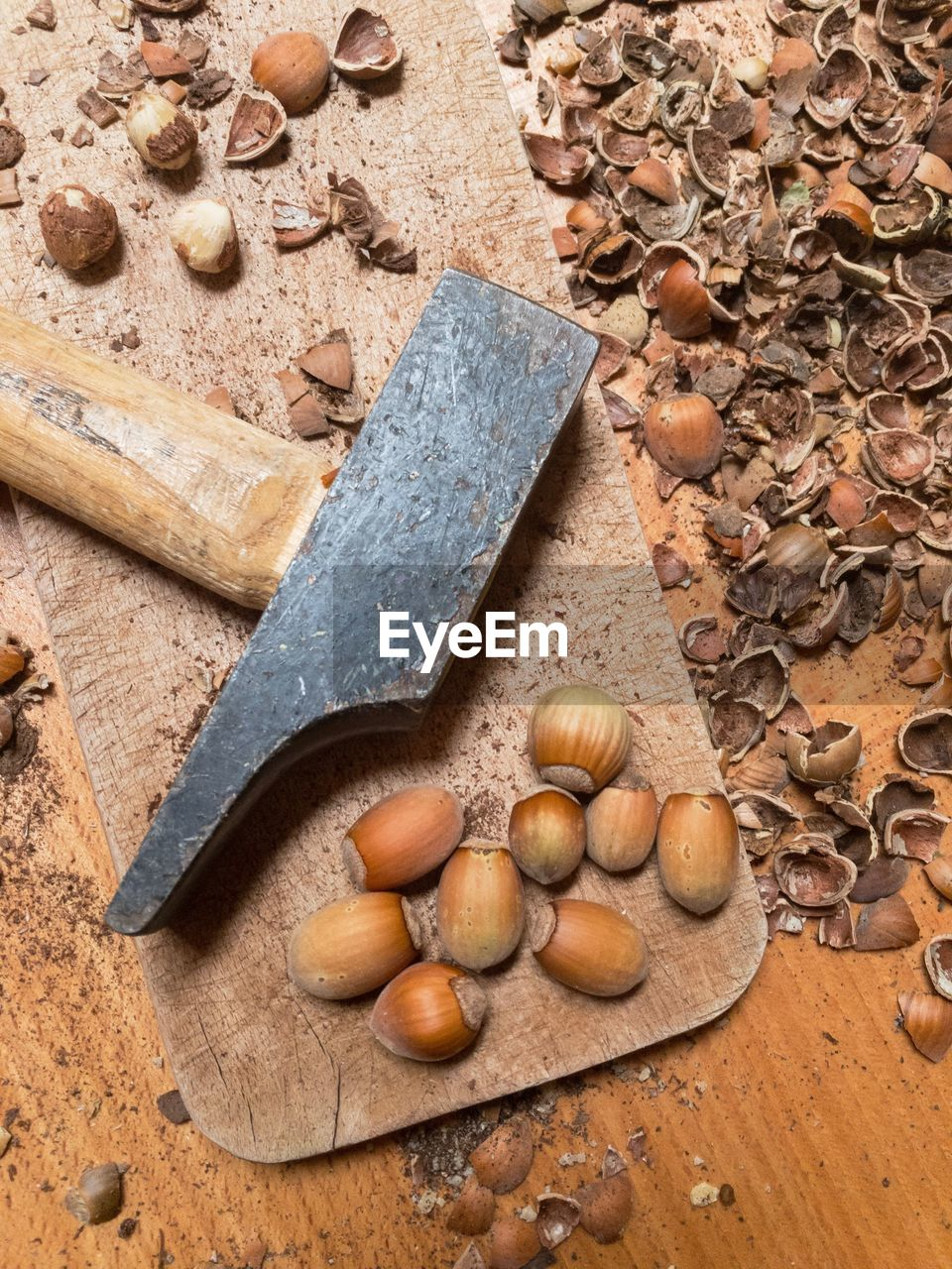 High angle view of nuts next to hammer