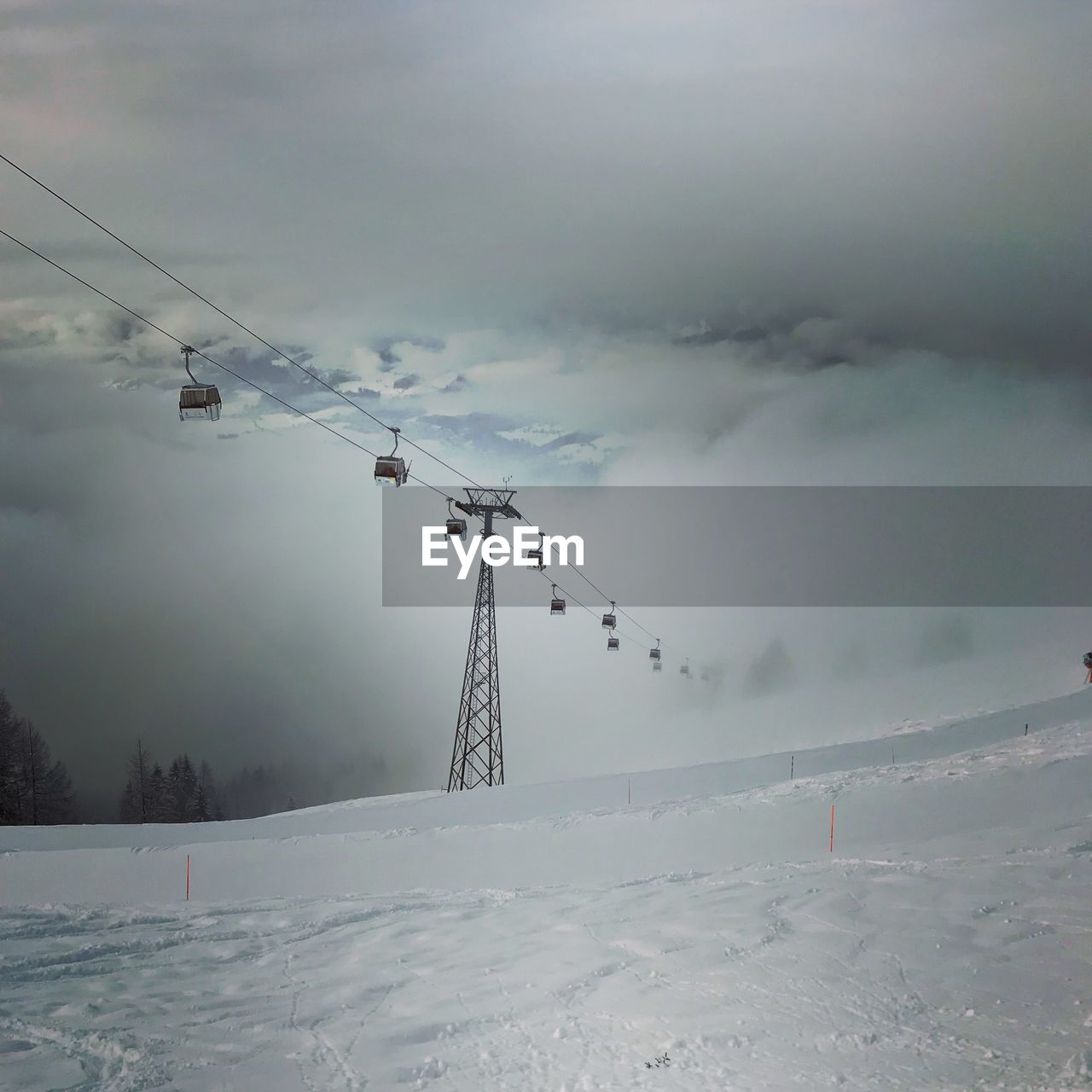 winter, cold temperature, snow, sky, cloud - sky, scenics - nature, beauty in nature, environment, covering, nature, field, white color, tranquil scene, tranquility, landscape, cable car, cable, land, technology, no people, outdoors, electricity, snowcapped mountain, extreme weather