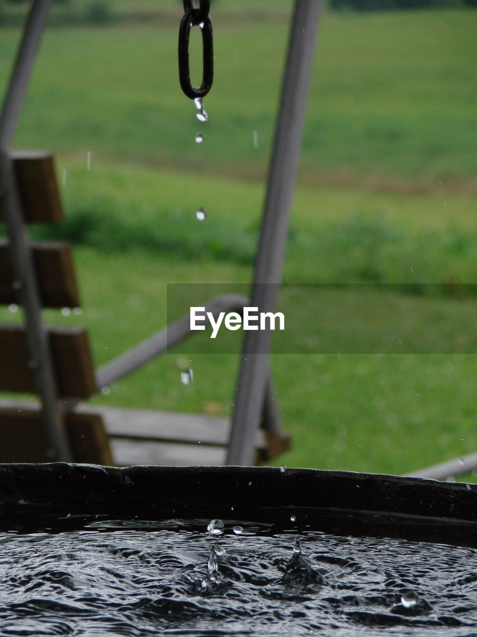 water, drop, motion, focus on foreground, wet, fountain, no people, dripping, splashing, nature, drinking fountain, outdoors, raindrop, running water, day, high-speed photography, beauty in nature, shower head, grass, close-up, splashing droplet