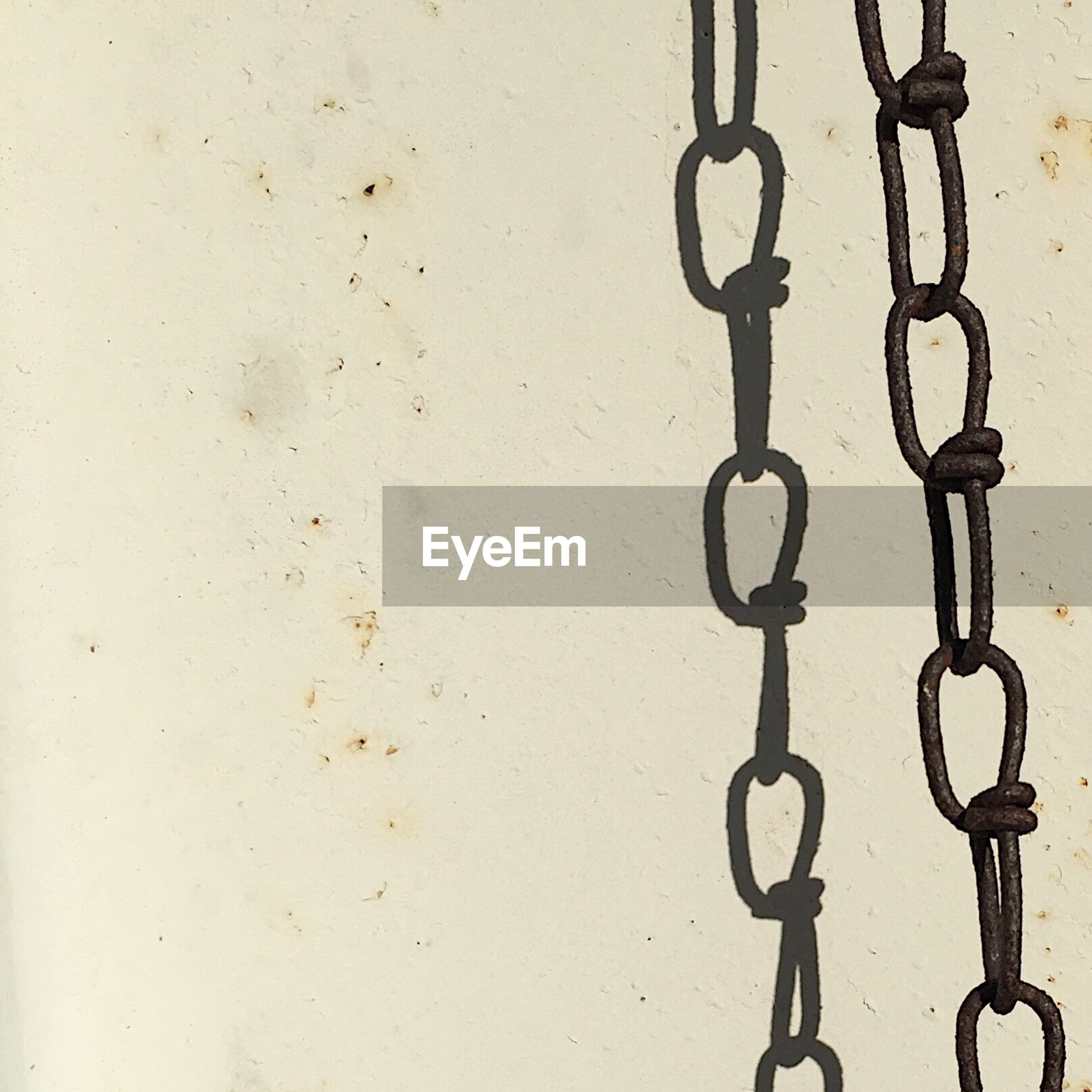 Close-up of chain against wall
