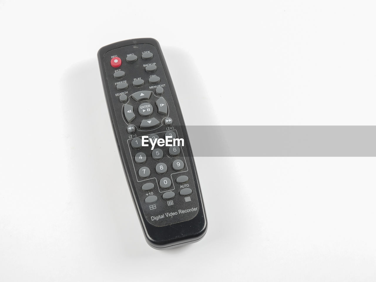 High angle view of remote control over white background