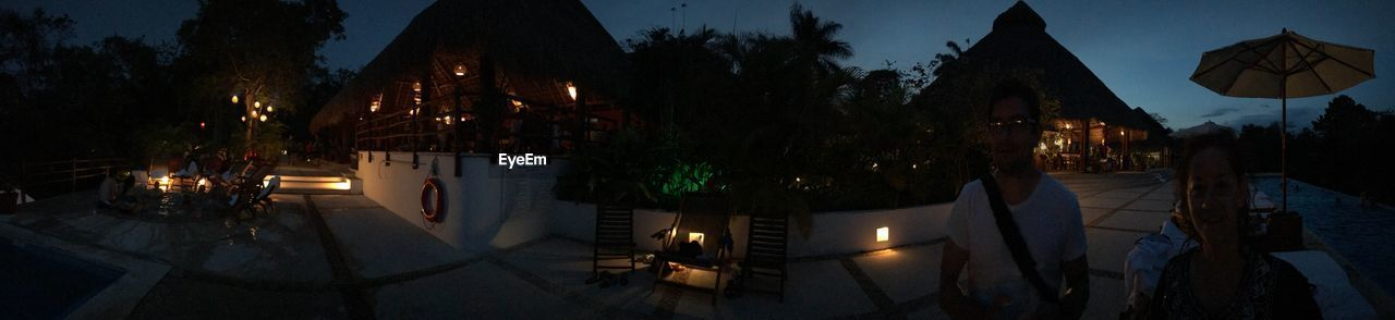 illuminated, night, tree, nature, architecture, panoramic, plant, dusk, lighting equipment, built structure, building exterior, no people, parasol, sky, outdoors, glowing, water, high angle view, street, light, swimming pool