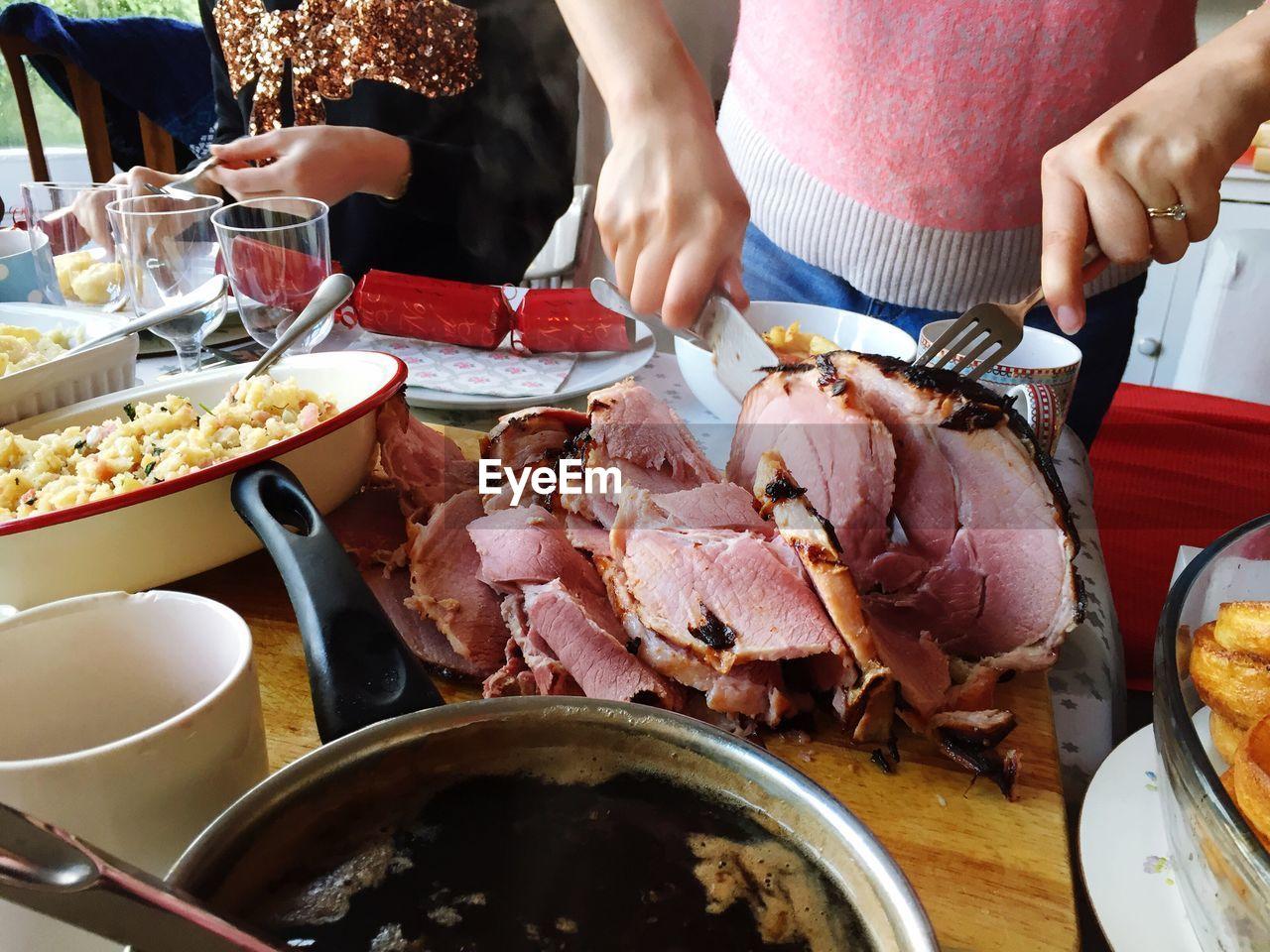Woman Carving Ham
