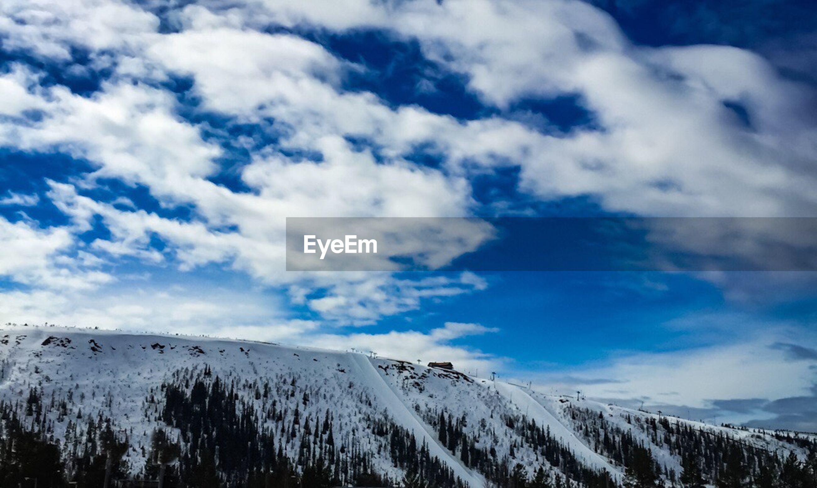 sky, tranquility, tranquil scene, snow, cloud - sky, winter, scenics, cold temperature, beauty in nature, landscape, nature, cloud, cloudy, weather, white color, blue, low angle view, day, outdoors, non-urban scene