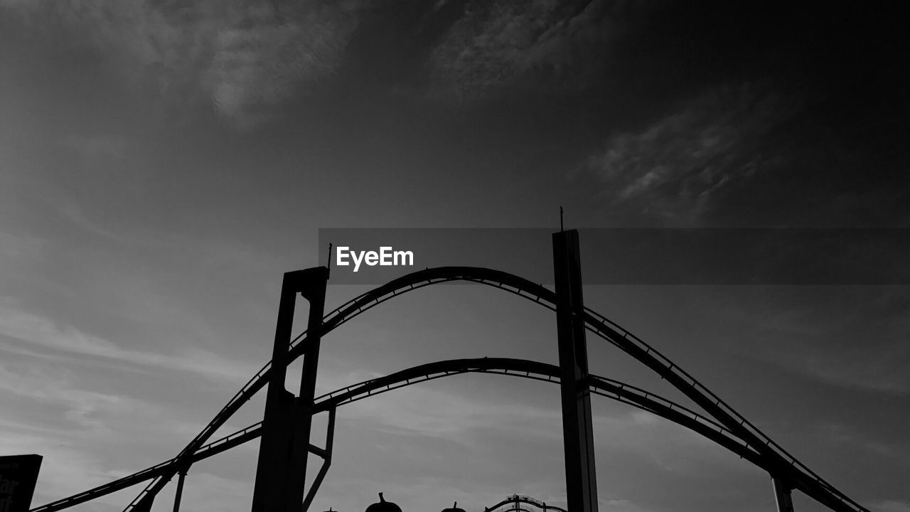 sky, cloud - sky, low angle view, architecture, built structure, nature, no people, metal, connection, bridge - man made structure, bridge, outdoors, day, city, silhouette, travel destinations, tall - high, tourism