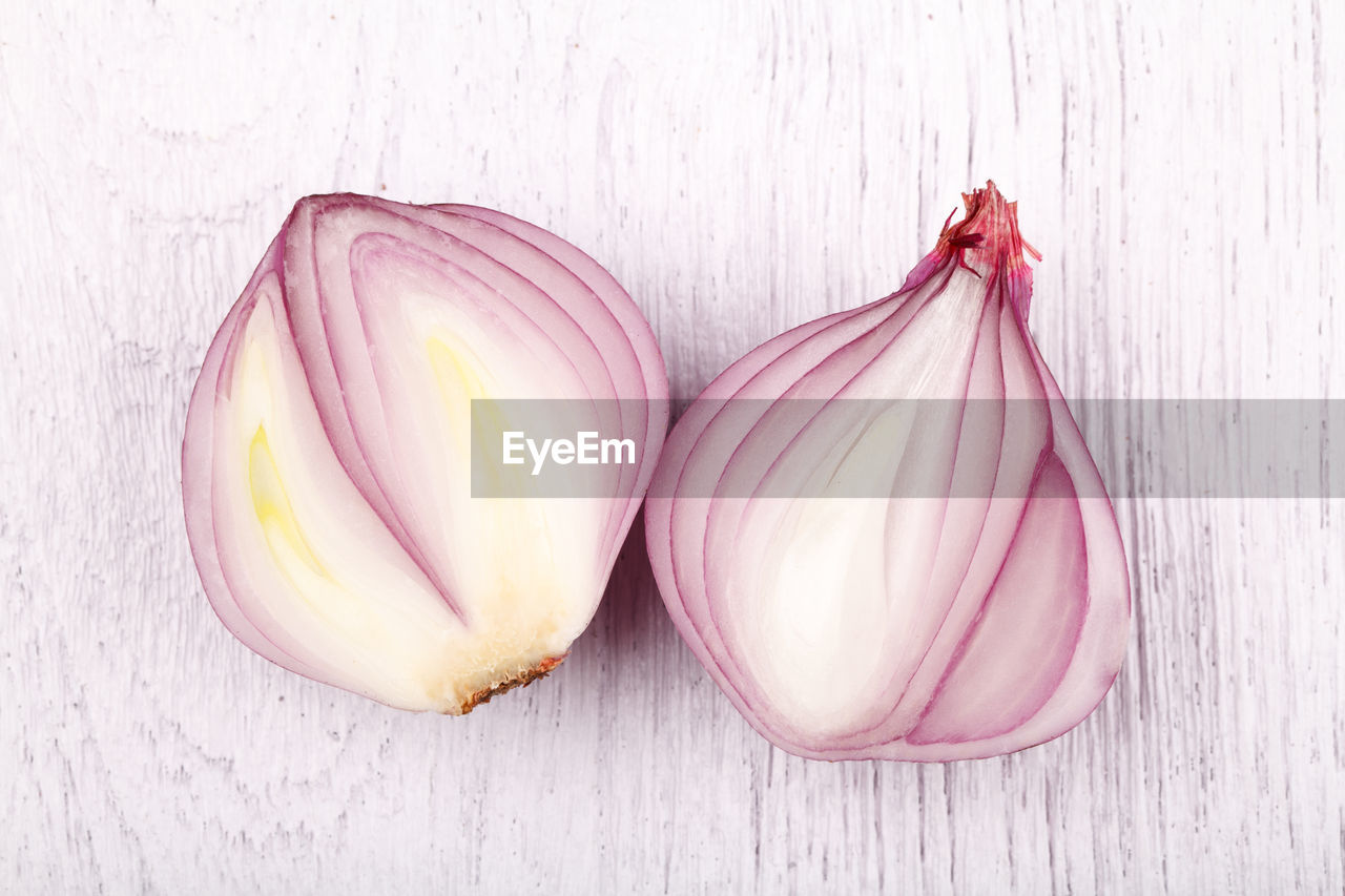 freshness, food, food and drink, pink color, wellbeing, indoors, still life, vegetable, healthy eating, close-up, no people, onion, table, raw food, purple, group of objects, wood - material, ingredient, studio shot, two objects, garlic clove, vegetarian food