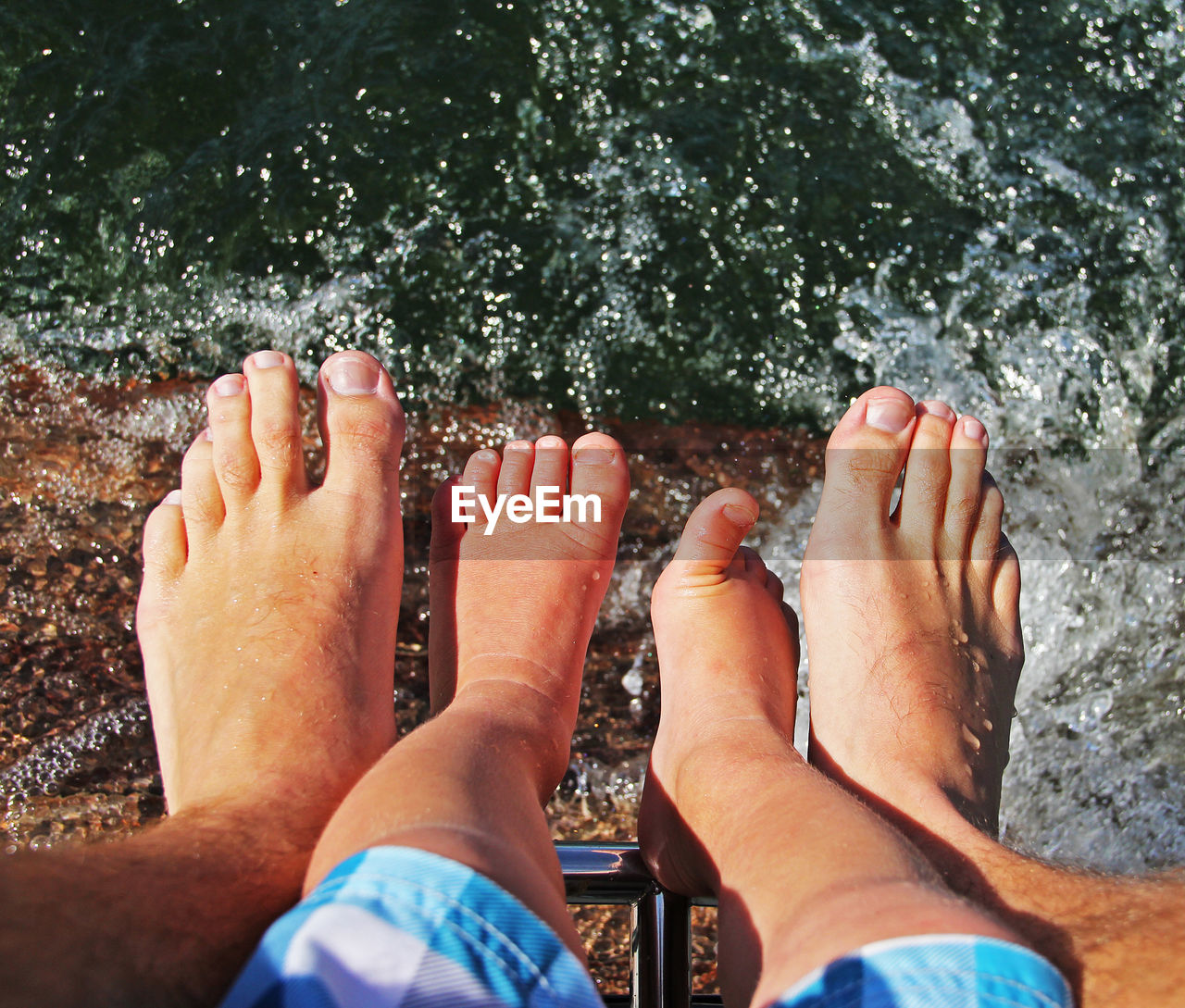human body part, real people, barefoot, body part, low section, personal perspective, human leg, nature, leisure activity, two people, lifestyles, people, day, water, men, human foot, togetherness, outdoors, sunlight, couple - relationship