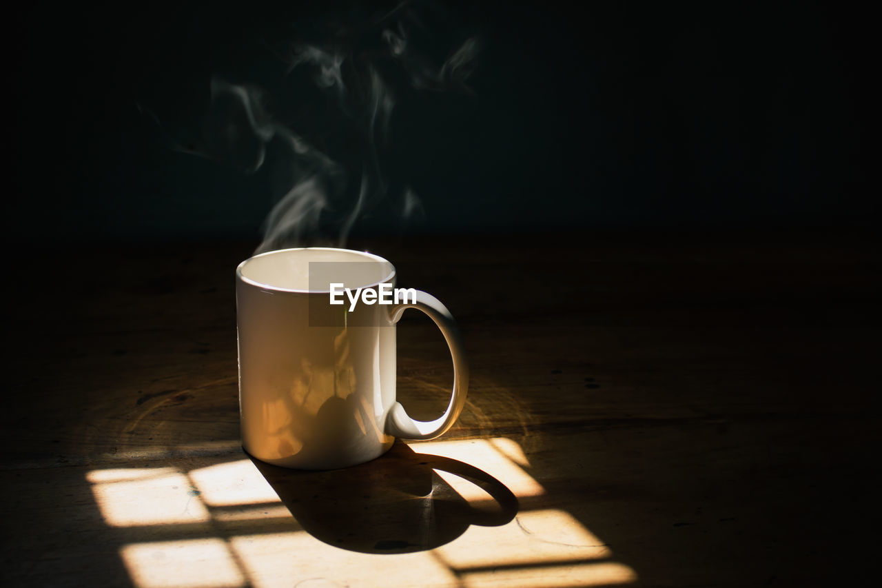 cup, refreshment, drink, mug, indoors, smoke - physical structure, table, food and drink, still life, coffee, steam, coffee cup, no people, coffee - drink, shadow, wood - material, heat - temperature, tea, hot drink, tea - hot drink, tea cup, non-alcoholic beverage