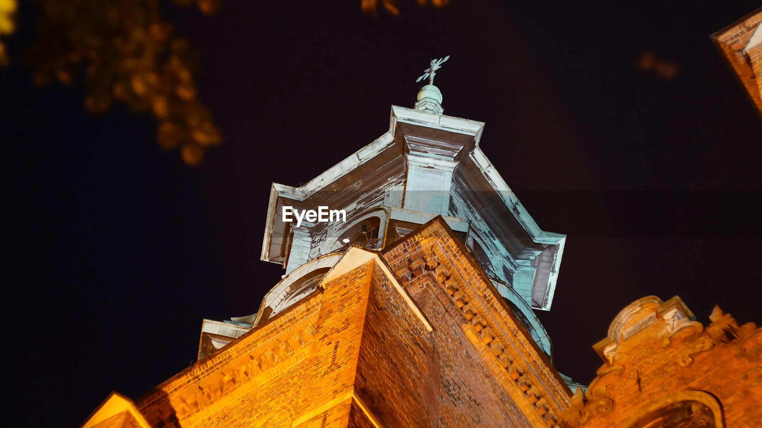 Low angle view of bell tower against sky at night