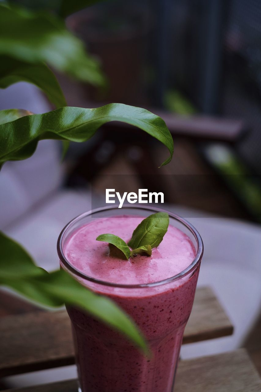 Close-up of smoothie served on table