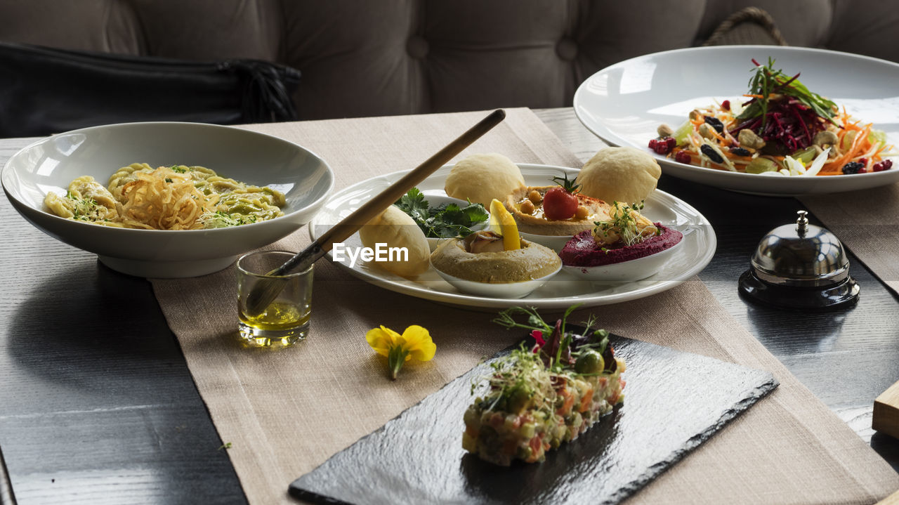 Food served in bowls and plates on table